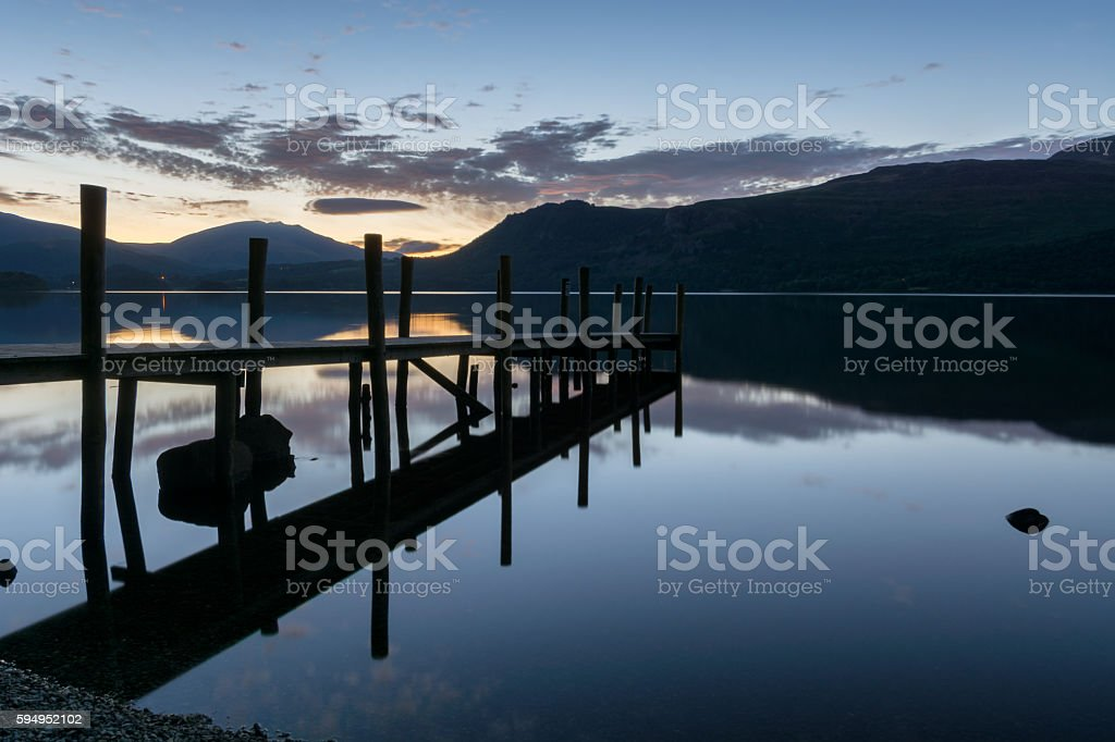 Dawn Silhouette At Lake With Jetty. stock photo