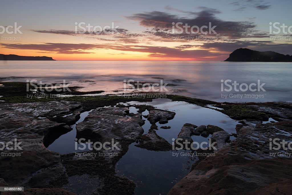 Dawn skies from Green Point Pearl Beach stock photo