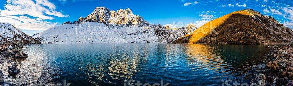 Dawn sunlight on tranquil mountain lake peaks Gokyo Himalayas Nepal stock photo