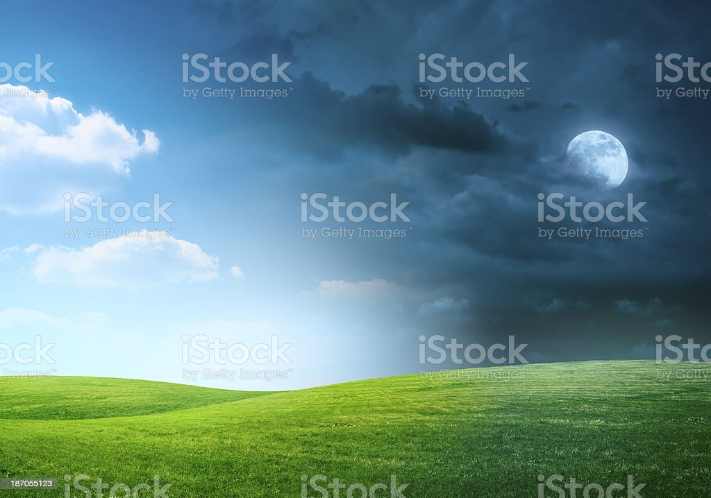 Day and night on meadow stock photo