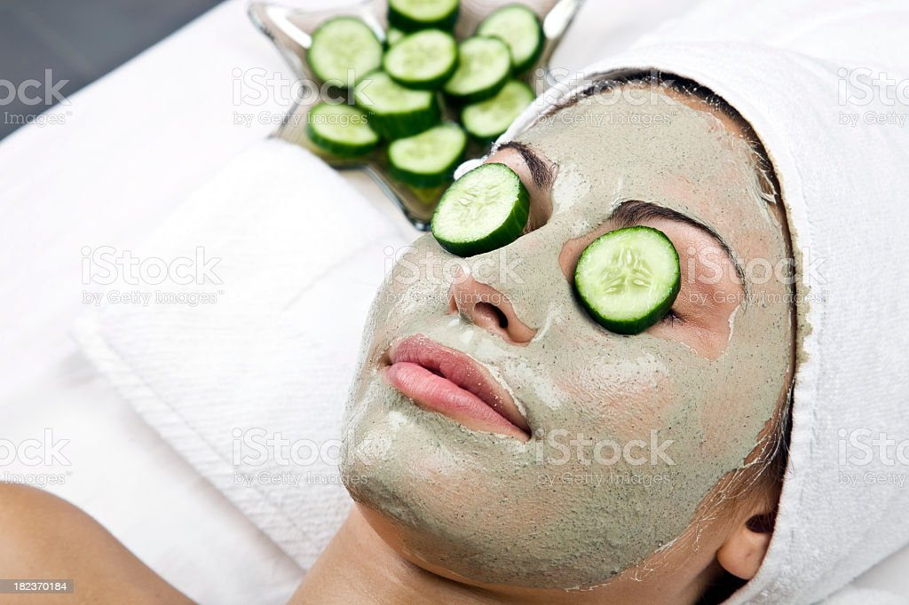Day at the spa with relaxing facial cucumber mask royalty-free stock photo