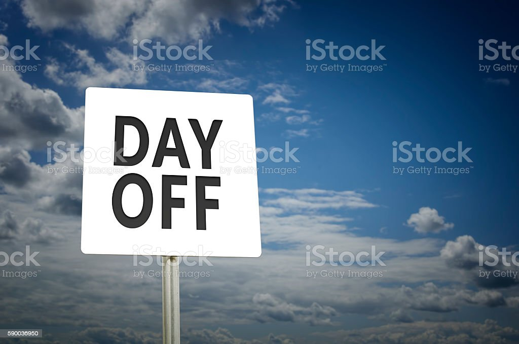 Day Off sign with blue sky stock photo