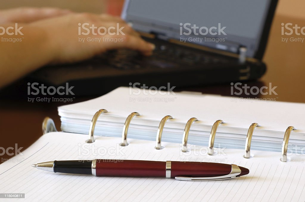 Day Planner and Female Hands Typing on a Laptop Computer royalty-free stock photo