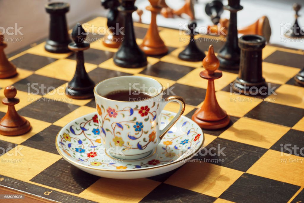 Day planning concept. Strategy board game Chess with a cup of hot coffee. stock photo