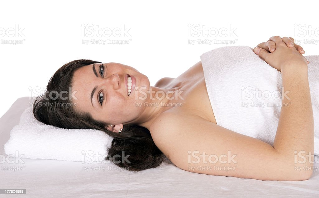 Day spa woman on massage table royalty-free stock photo