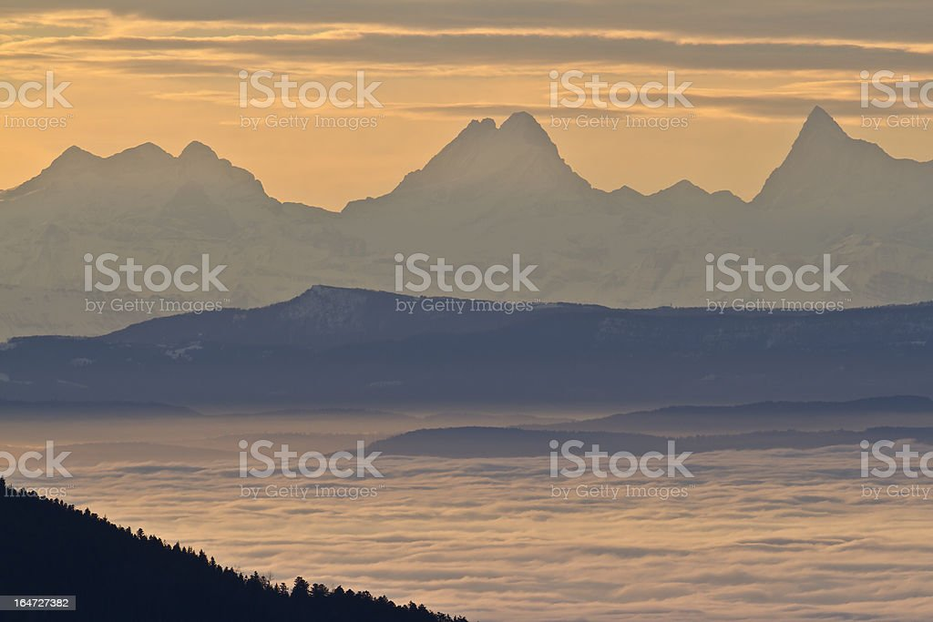 Day sunrise on the Swiss chain of Alps mountain stock photo