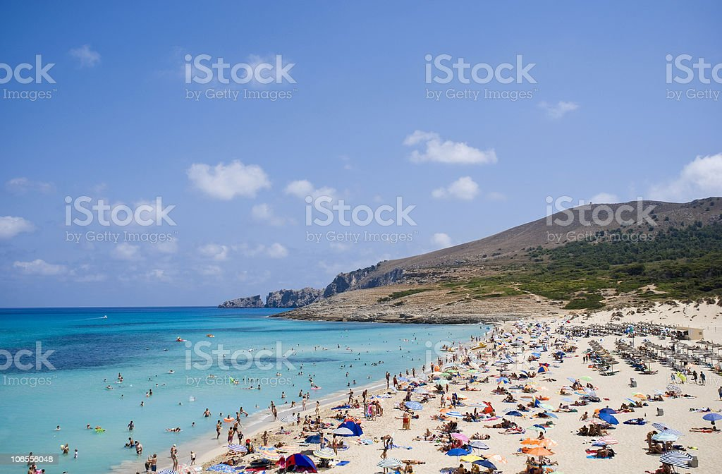 A day time view of a busy beach royalty-free stock photo