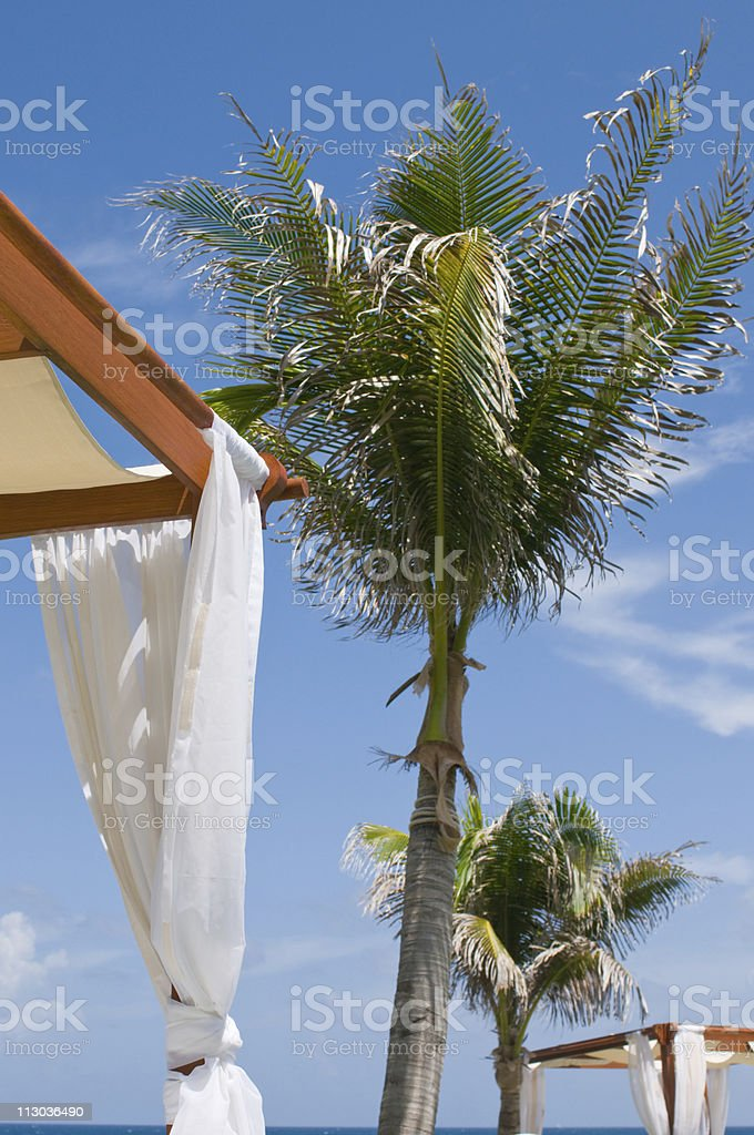 Daybeds at luxury tropical oceanfront spa stock photo