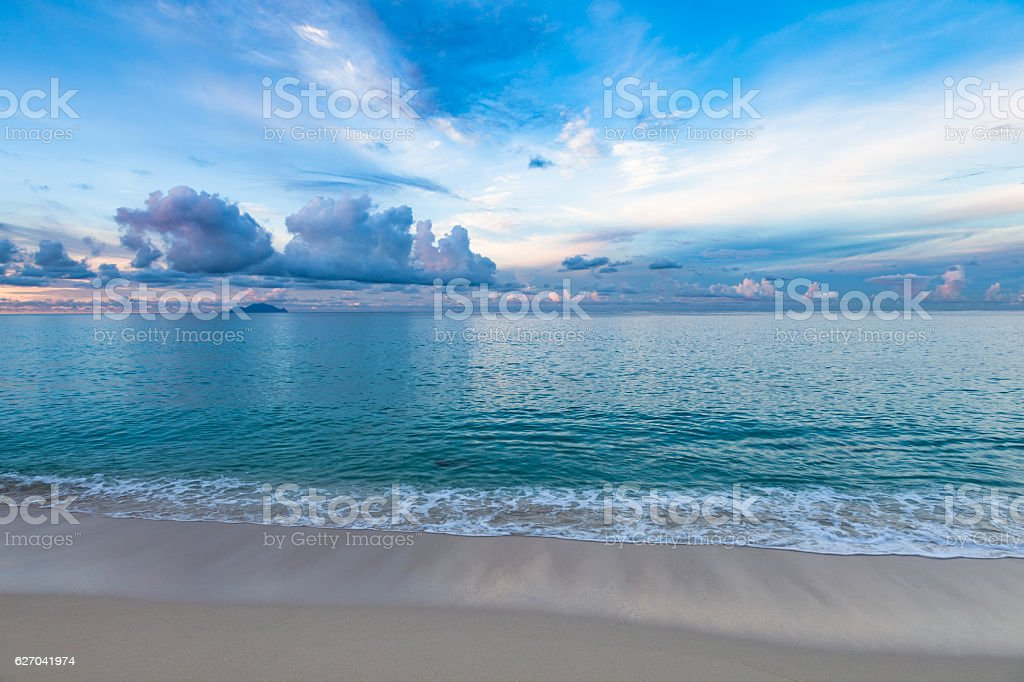 Daybreak Caribbean seaside with Saba on the horizon stock photo