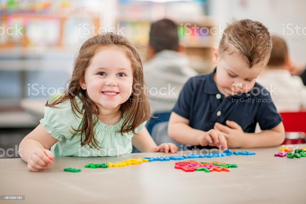 Daycare Children Learing to Spell stock photo