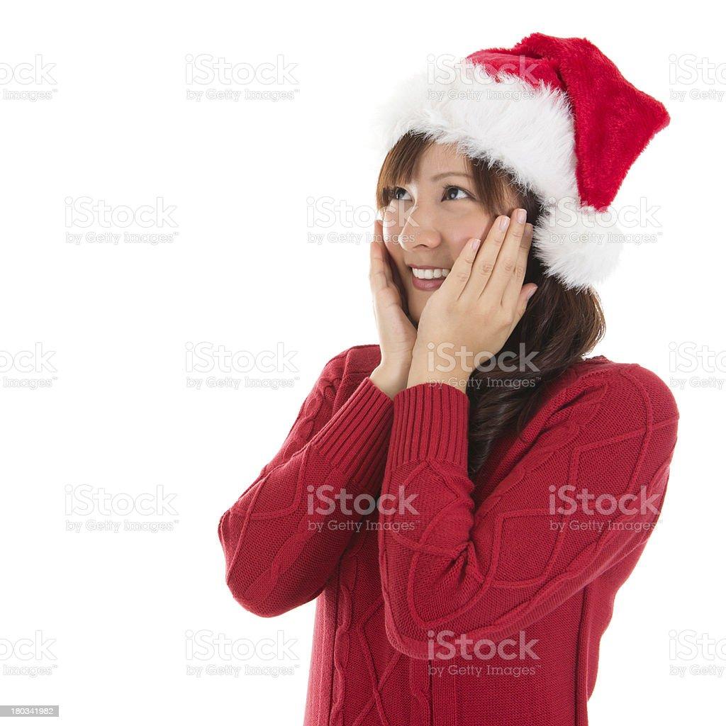 Daydreaming Asian Christmas woman royalty-free stock photo