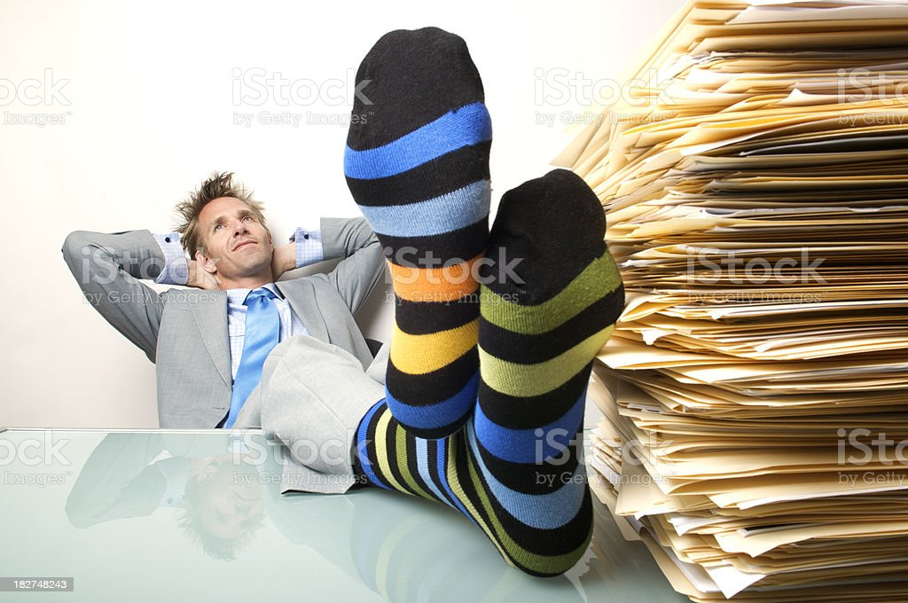 Daydreaming Businessman Office Worker Putting Striped Socks Feet Up Desk stock photo