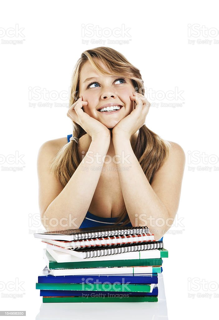 Daydreaming female teenager with books royalty-free stock photo