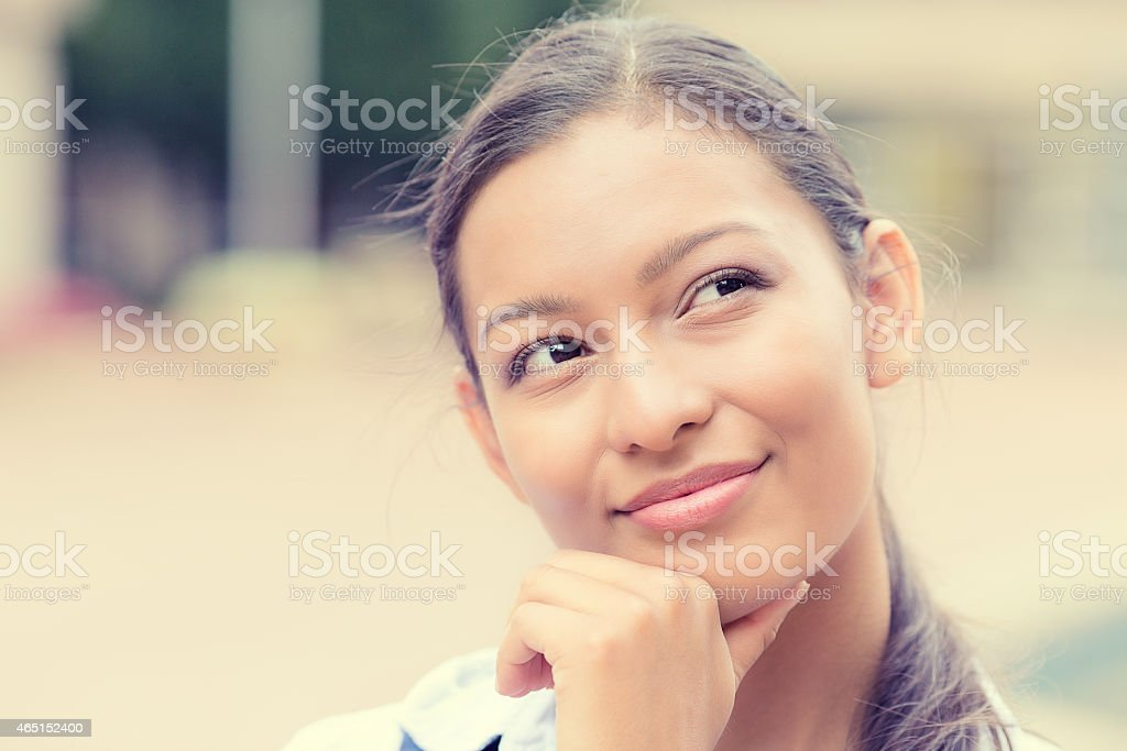 Daydreaming happy woman stock photo