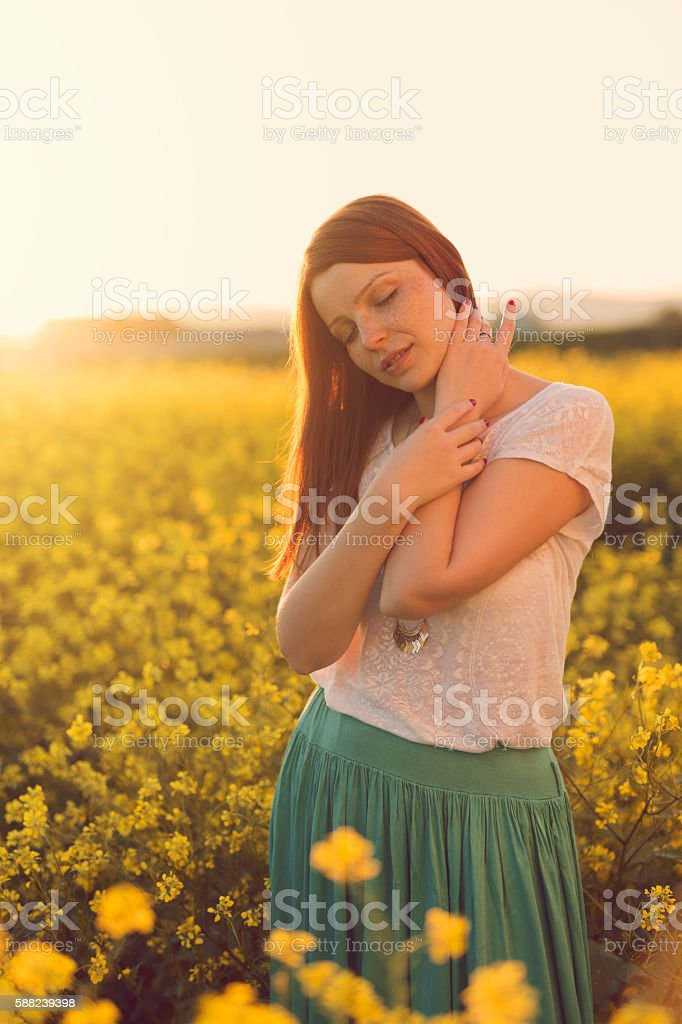 Daydreaming in yellow garden stock photo