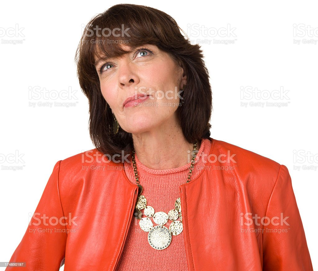 Daydreaming Mature Woman Looks Up royalty-free stock photo