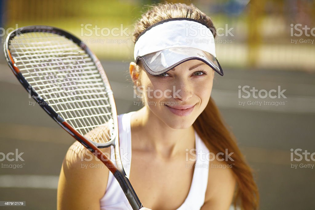 Daydreaming of winning her match royalty-free stock photo
