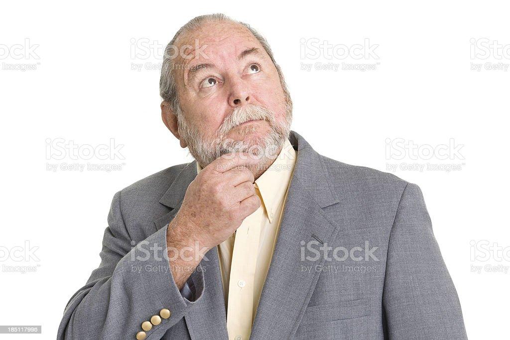 Daydreaming Senior Man Looks Up stock photo