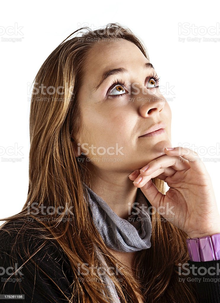 Daydreaming young blonde beauty looks upwards stock photo