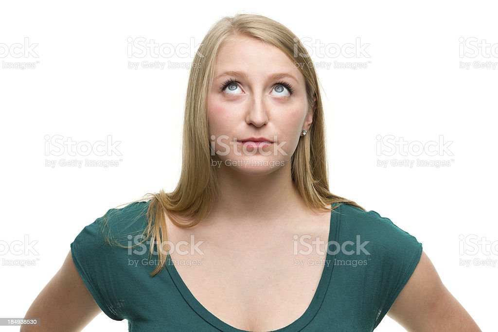Daydreaming Young Woman Looks Up stock photo