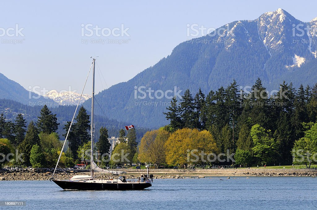 Daylight landscape of Vancouver harbour with boat and mountians range royalty-free stock photo