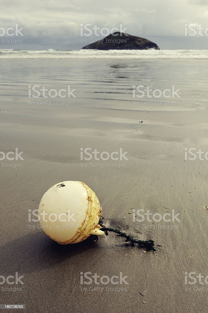 Daylight landscape with old buoy and remote island royalty-free stock photo