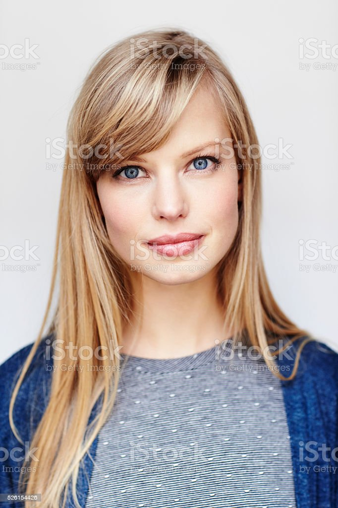 Daylight portrait of beautiful and blue eyed young woman stock photo