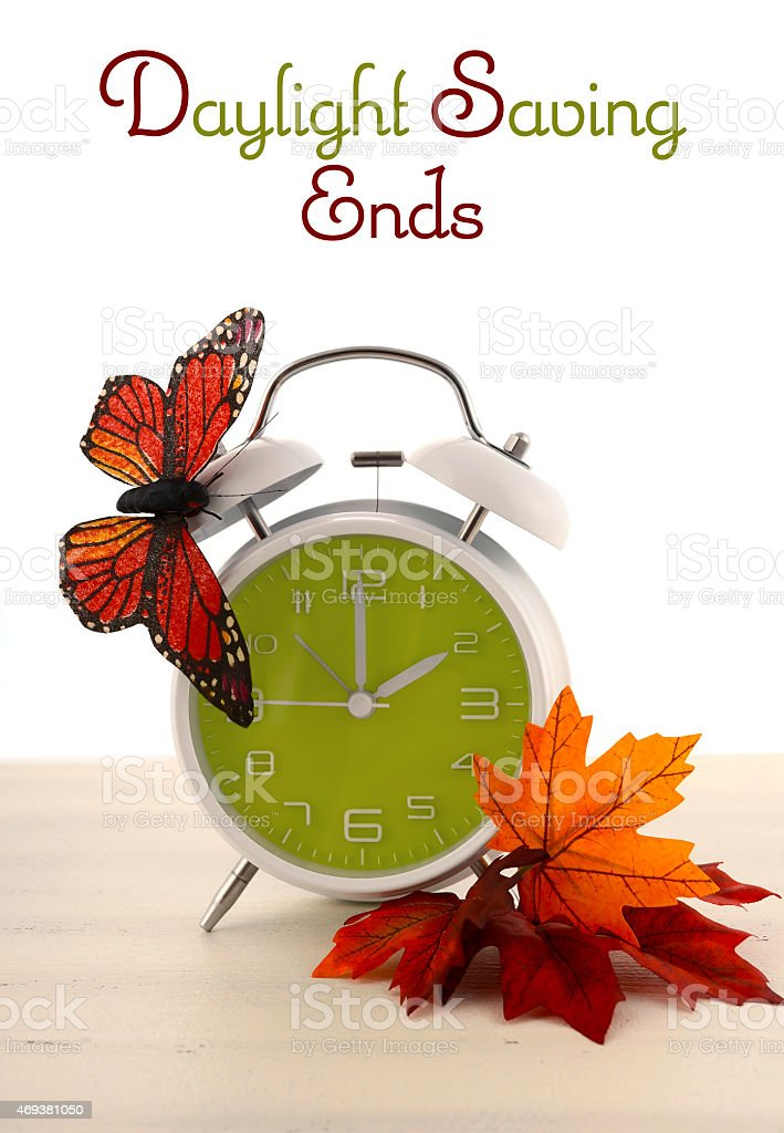 Daylight Saving Time Ends concept with Autumn Fall theme. stock photo