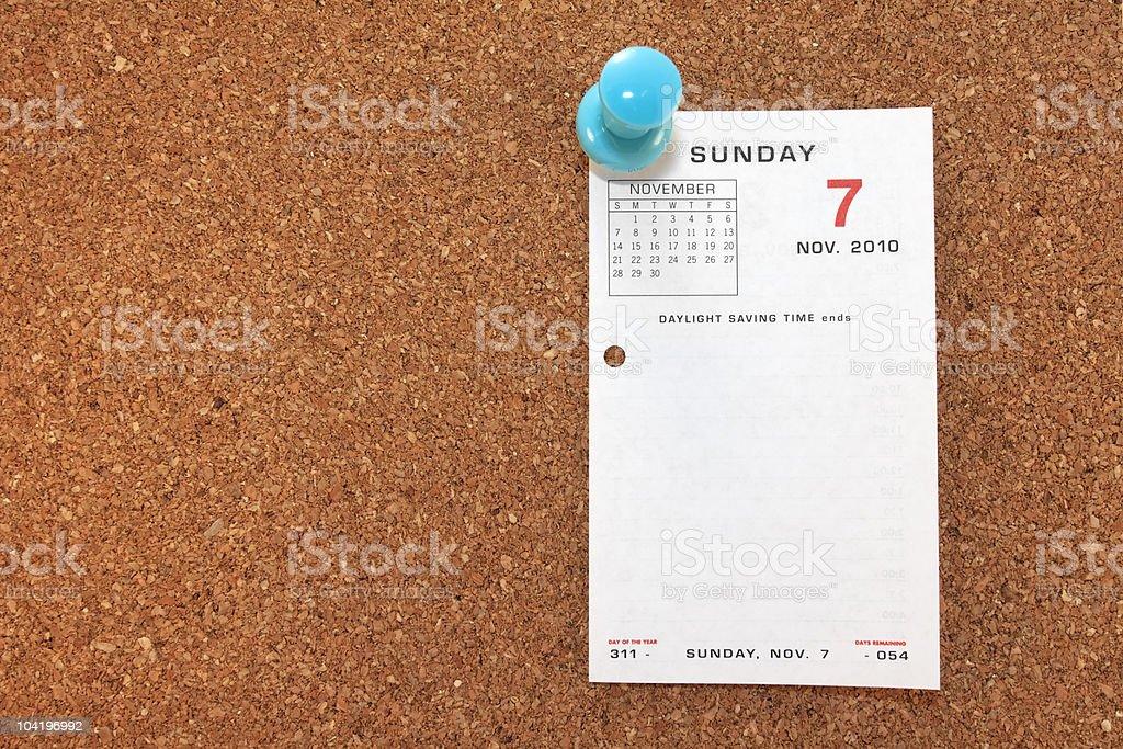 Daylight Savings Calendar Page On Corkboard royalty-free stock photo