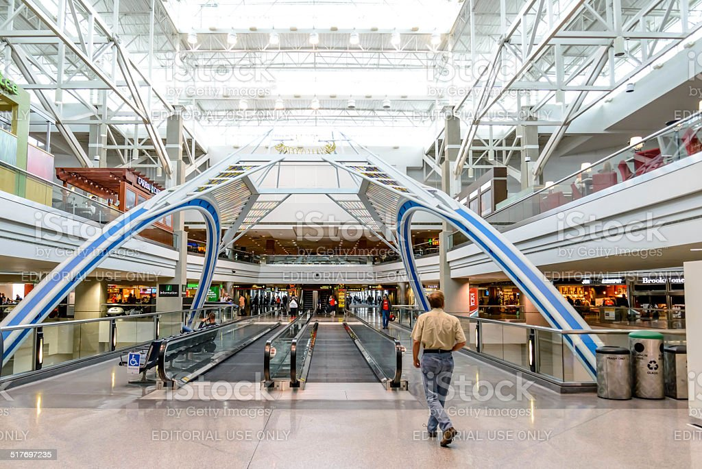 Daylighting roof structure with people walking and people movers stock photo