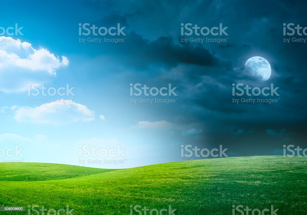 Day-night transition over hilly meadow. stock photo