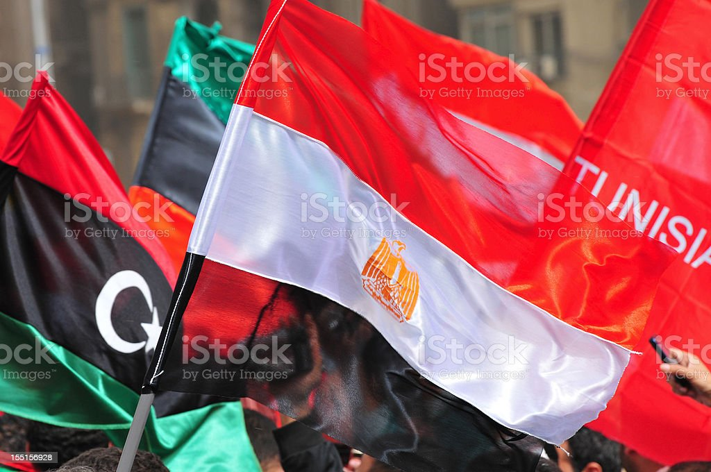 Flags of Libya, Egypt, and Tunisia (Tahrir Square, Cairo, Egypt) stock photo