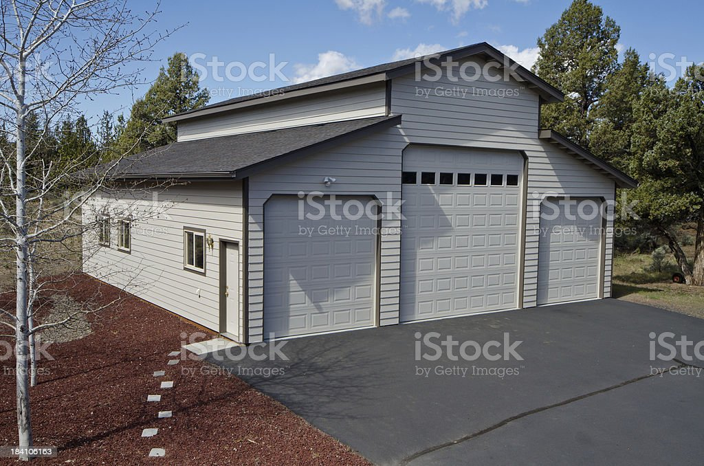 Daytime exterior of three car garage royalty-free stock photo