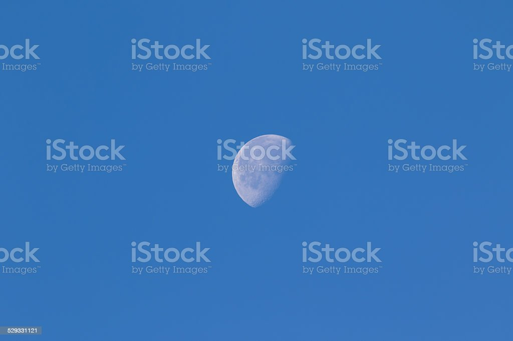 Daytime visible moon stock photo