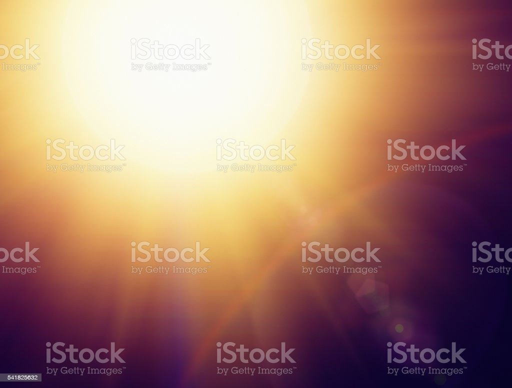 Dazzling golden bright midday sun as background stock photo