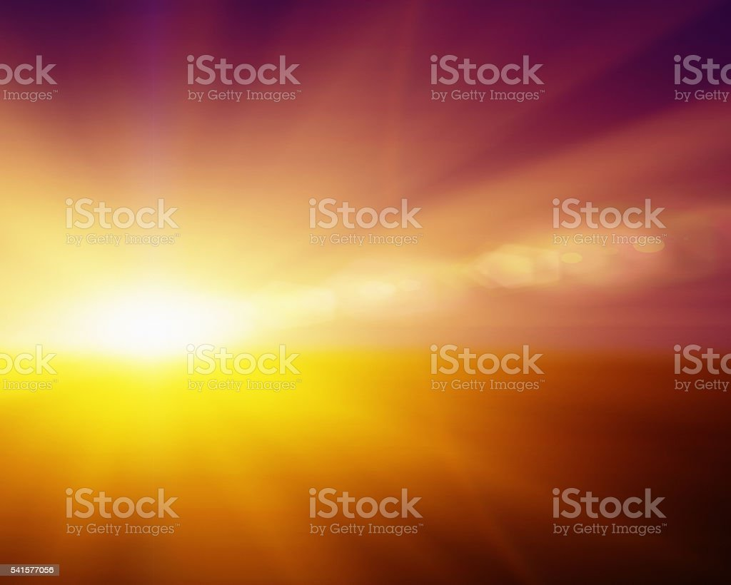 Dazzling sunrise or sunset; bright rays with copy space stock photo
