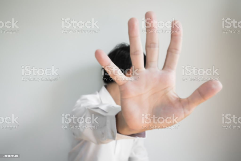 De focused a man showing palm hand, concept of denial stock photo