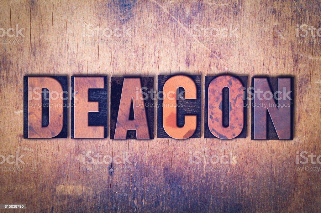 Deacon Theme Letterpress Word on Wood Background stock photo