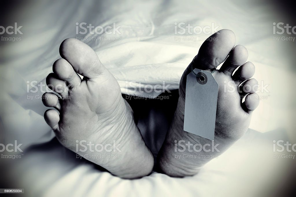 dead body with a blank toe tag, in monochrome stock photo