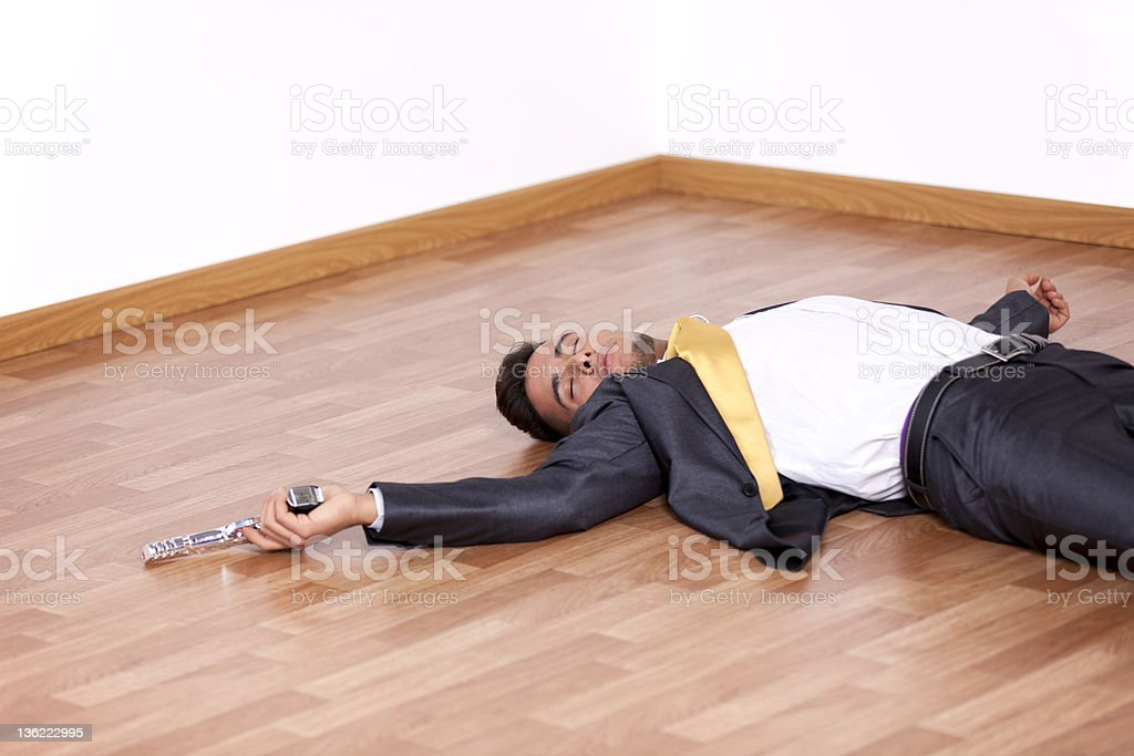 Dead businessman in the floor royalty-free stock photo