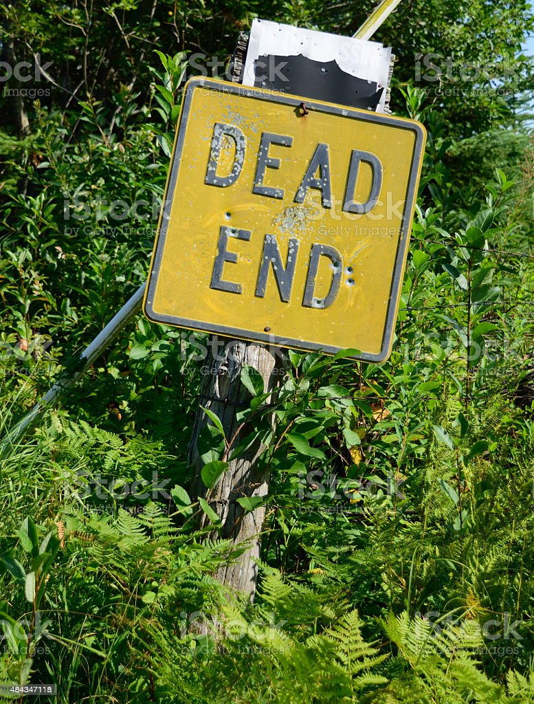 Dead End Sign with Bullet Holes stock photo