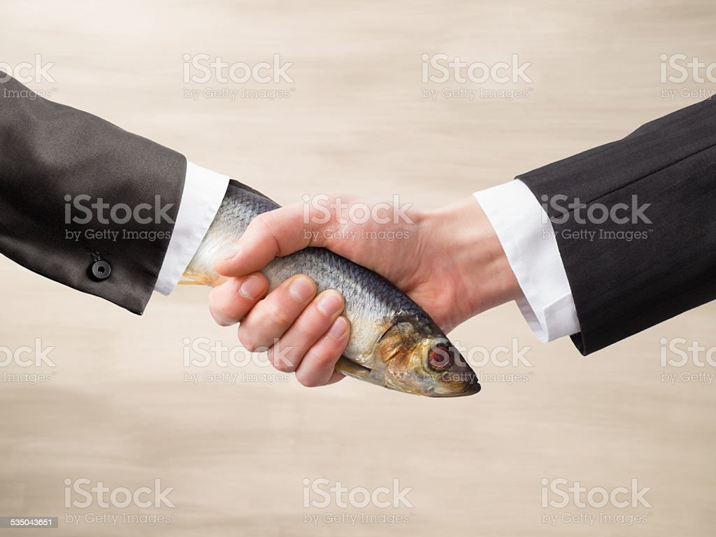 Dead Fish Handshake stock photo
