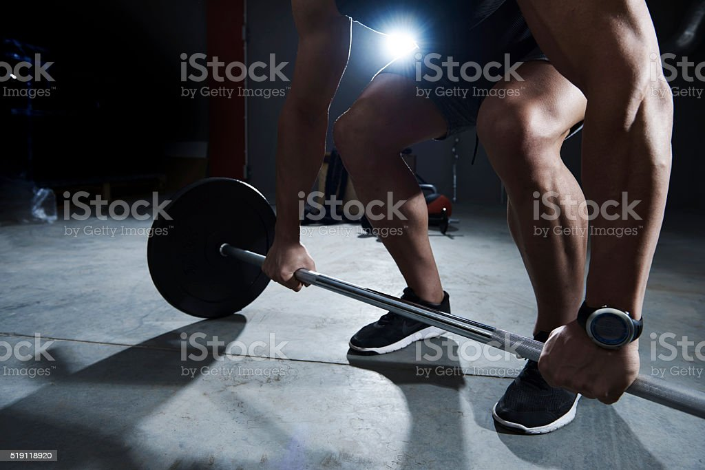 Dead lift made by athlete man stock photo