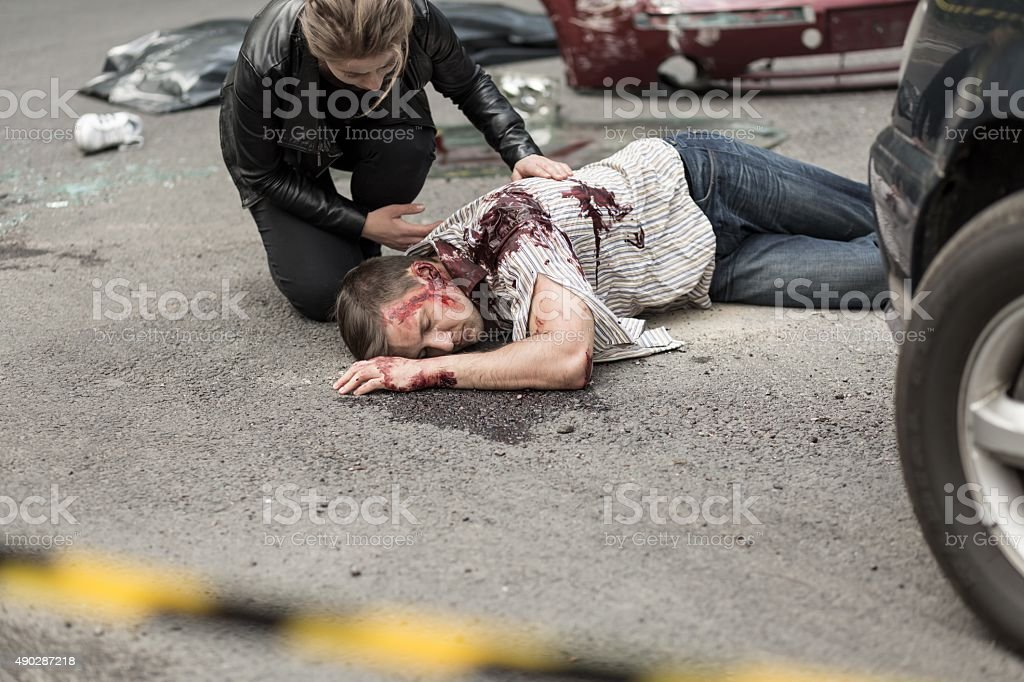 Dead man after car crash stock photo