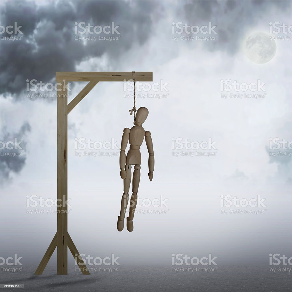 Dead Man hanging on a gallows in the cloudy night stock photo