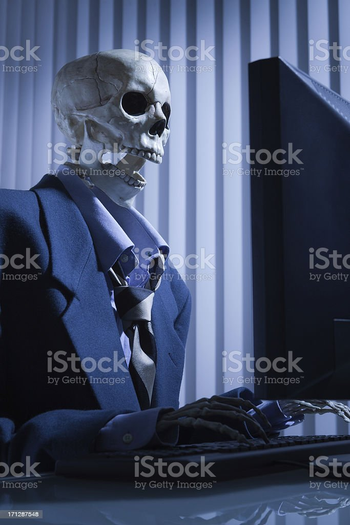 Dead Overworked Exhausted Worker Working in the Office Close-up stock photo