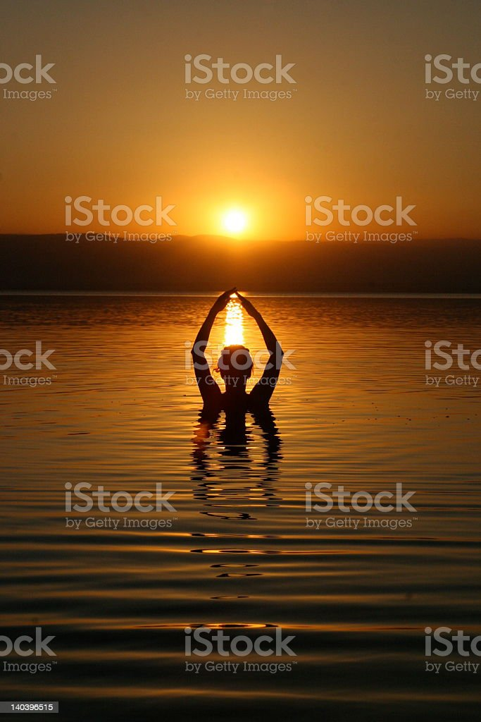 Dead Sea at sunset with person in the water royalty-free stock photo