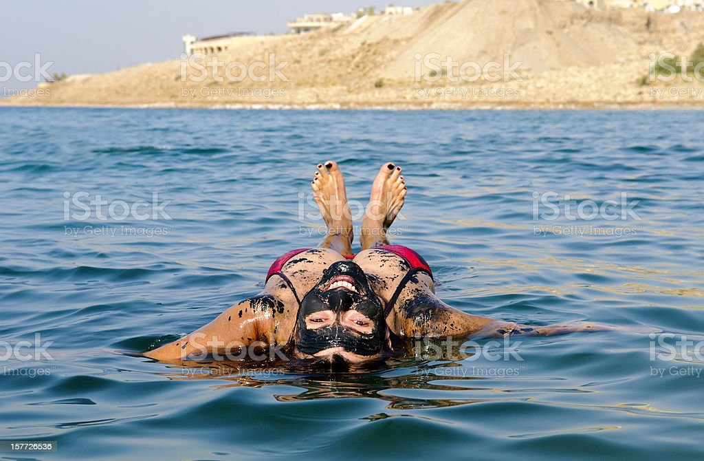 Dead Sea vacation with woman floating on back royalty-free stock photo