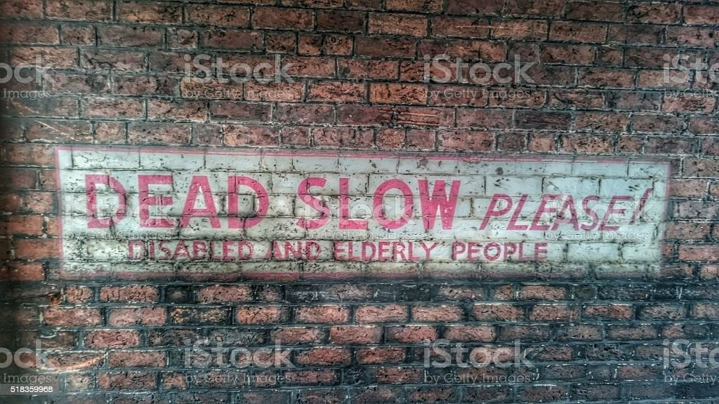 Dead Slow Please Vintage Painted Sign stock photo