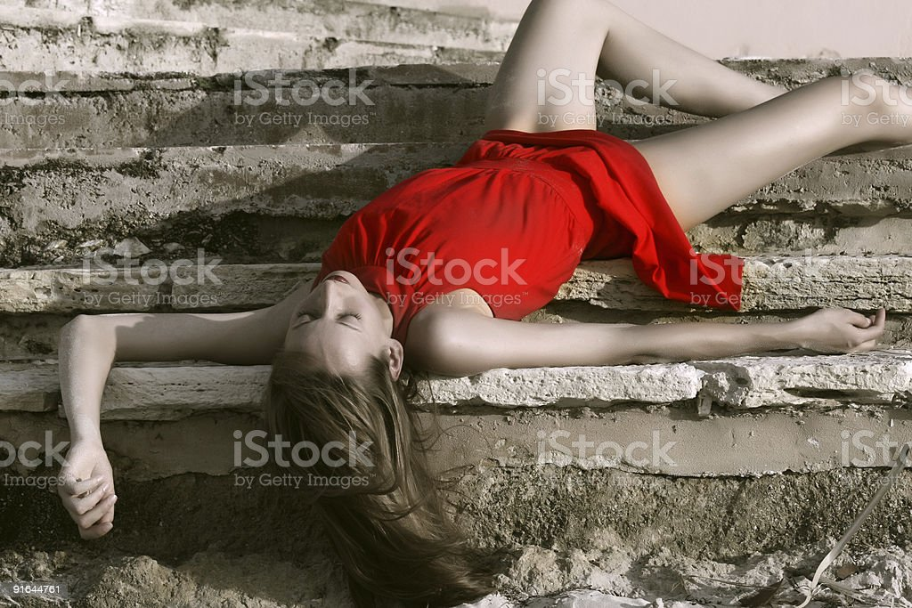 dead woman in red dress royalty-free stock photo